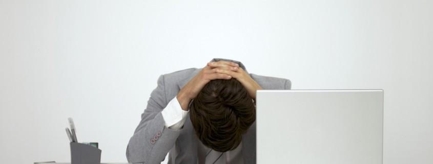 Unhappy man at desk